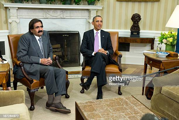 US President Barack Obama right speaks during a meeting with Hamad bin Khalifa alThani the Amir of Qatar in the Oval Office of the White House on...
