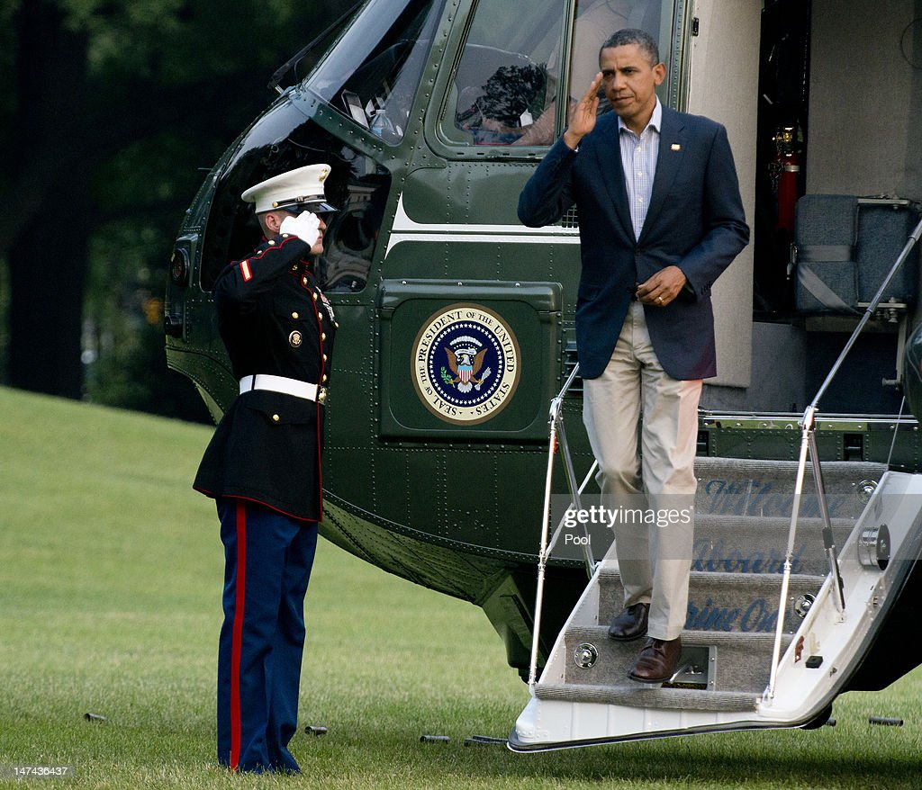 U.S. President <a gi-track='captionPersonalityLinkClicked' href=/galleries/search?phrase=Barack+Obama&family=editorial&specificpeople=203260 ng-click='$event.stopPropagation()'>Barack Obama</a> salutes after landing on the South Lawn of the White House aboard Marine One June 29, 2012 in Washington, D.C. The president was returning from a trip to Colorado Springs, Colorado to view damage from the wildfires raging there and to thank emergency workers for their efforts.