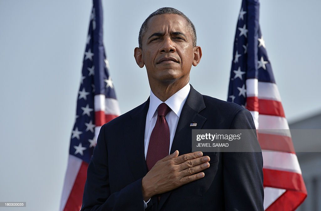 US President Barack Obama salutes during the palying of the National Anthem during a ceremony at the Pentagon Memorial to mark the 12th anniversary of the 9/11 attacks in Washington, DC, on September 11, 2013. AFP PHOTO/Jewel Samad