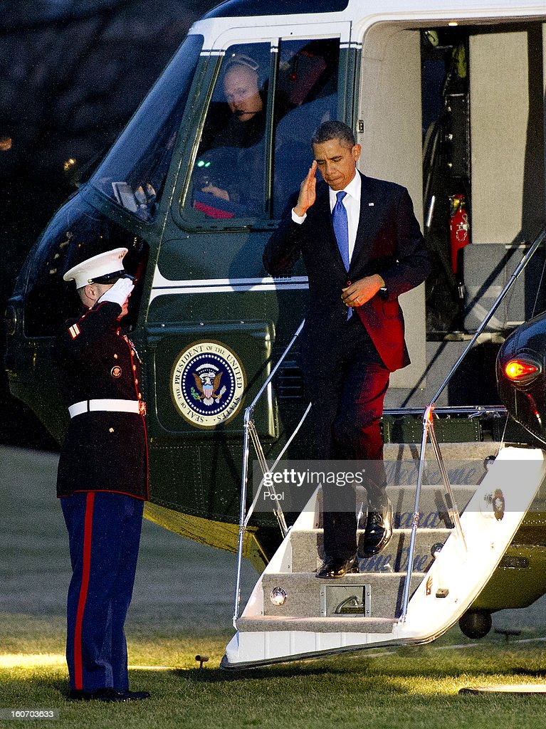 U.S. President <a gi-track='captionPersonalityLinkClicked' href=/galleries/search?phrase=Barack+Obama&family=editorial&specificpeople=203260 ng-click='$event.stopPropagation()'>Barack Obama</a> salutes the Marine Guard as he arrives on the South Lawn of the White House on February 4, 2013 in Washington, D.C. Obama returned from a trip to Minneapolis, Minnesota to promote his initiative to reduce gun violence.