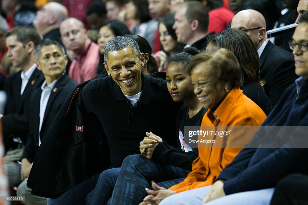 US President Barack Obama Sasha Obama and Marian Robinson attend a men's NCCA basketball game between University of Maryland and Oregon State...