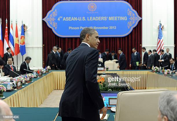 US President Barack Obama seats for the Association of Southeast Asian US leaders meeting at the Peace Palace in Phnom Penh on November 19 2012 Obama...