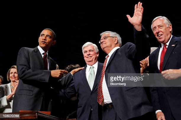 US President Barack Obama second from left points to Senate Banking Committee Chairman Christopher Dodd left center and House Financial Services...