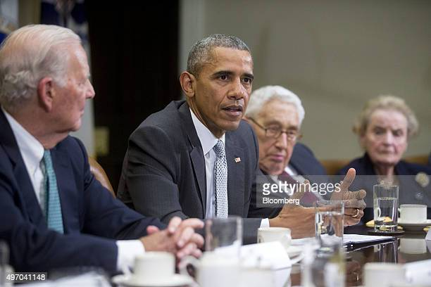 US President Barack Obama second left speaks while meeting with current and former diplomatic and national security officials including James Baker...