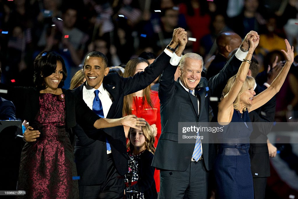 U.S. President Barack Obama, second left, waves to the crowd with First Lady Michelle Obama, left, U.S. Vice President Joseph 'Joe' Biden, second right, and his wife Jill Biden during an election night rally in Chicago, Illinois, U.S., in the early morning on Wednesday, Nov. 7, 2012. Obama, the post-partisan candidate of hope who became the first black U.S. president, won re-election today by overcoming four years of economic discontent with a mix of political populism and electoral math. Photographer: Daniel Acker/Bloomberg via Getty Images
