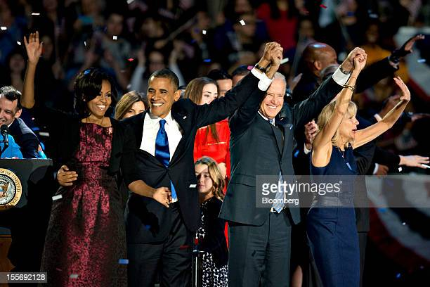 US President Barack Obama second left waves to the crowd with First Lady Michelle Obama left US Vice President Joseph 'Joe' Biden second right and...