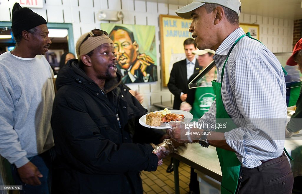 Attractive US President Barack Obama (R) Serves Food At U0027So Others Might Eatu0027