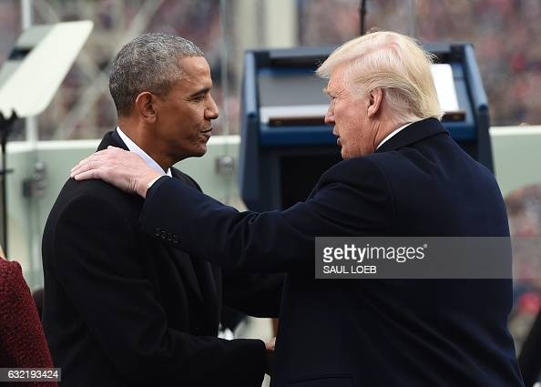 President Barack Obama shake hands with Presidentelect Donald Trump during the Presidential Inauguration at the US Capitol in Washington DC on...