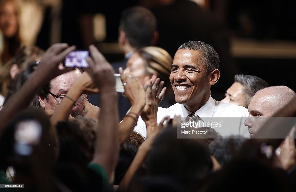 U.S. President <a gi-track='captionPersonalityLinkClicked' href=/galleries/search?phrase=Barack+Obama&family=editorial&specificpeople=203260 ng-click='$event.stopPropagation()'>Barack Obama</a> shakes hands after speaking during a campaign stop at the Palace of Agriculture on the Colorado State Fairgrounds August 9, 2012 in Pueblo, Colorado. Obama covered a number of topics including paying down our debt in a balanced way, job growth and creation and preventing a scheduled tax increase.