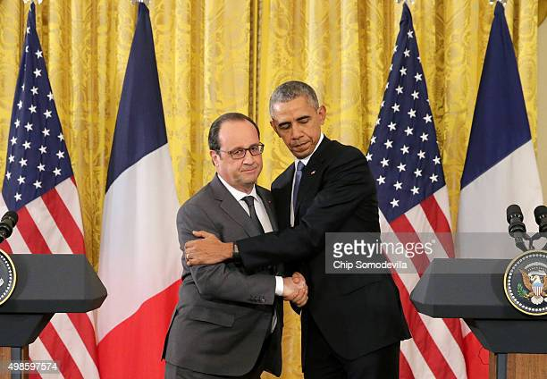 S President Barack Obama shakes hands and embraces French President Francois Hollande during a joint press conference in the East Room of the White...
