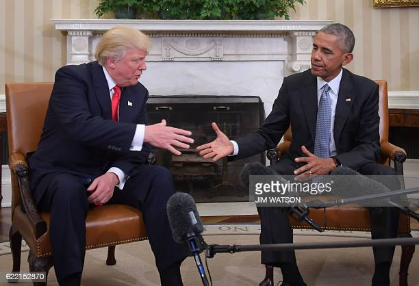 US President Barack Obama shakes hands as he meets with Republican Presidentelect Donald Trump on transition planning in the Oval Office at the White...