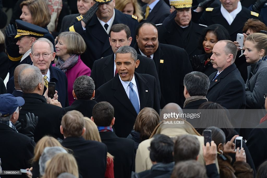 US President Barack Obama shakes hands during the 57th Presidential Inauguration ceremonial swearing-in at the US Capitol on January 21, 2013 in Washington, DC. The oath was administered by US Supreme Court Chief Justice John Roberts, Jr. AFP PHOTO / Saul LOEB