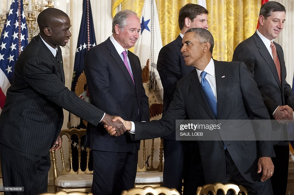 US President <a gi-track='captionPersonalityLinkClicked' href=/galleries/search?phrase=Barack+Obama&family=editorial&specificpeople=203260 ng-click='$event.stopPropagation()'>Barack Obama</a> shakes hands following an event highlighting Joining Forces hiring initiative for military veterans and spouses in civilian jobs in the East Room of the White House in Washington, DC, on April 30, 2013. Since President Obama challenged American businesses to hire US military veterans and spouses in August 2011, they have hired or trained 290,000 military veterans and spouses and now pledge to hire or train an additional 435,000 veterans and military spouses by 2018. AFP PHOTO / Saul LOEB