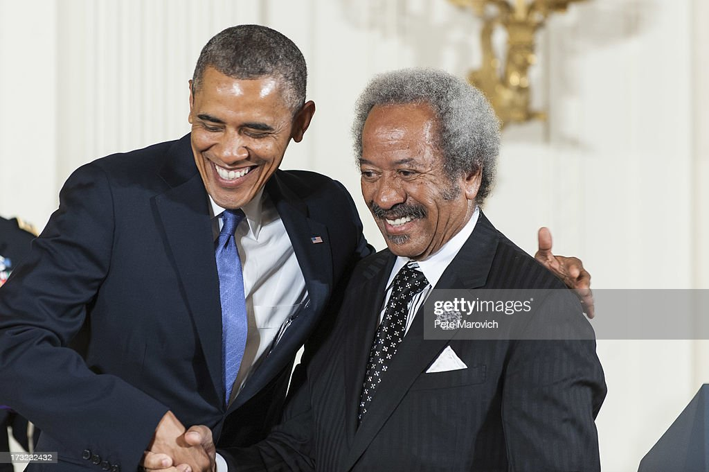U.S. President <a gi-track='captionPersonalityLinkClicked' href=/galleries/search?phrase=Barack+Obama&family=editorial&specificpeople=203260 ng-click='$event.stopPropagation()'>Barack Obama</a> (L) shakes hands with 2012 National Medal of Arts recipient <a gi-track='captionPersonalityLinkClicked' href=/galleries/search?phrase=Allen+Toussaint&family=editorial&specificpeople=647620 ng-click='$event.stopPropagation()'>Allen Toussaint</a> for his contributions as a composer, producer, and performer, during a ceremony in the East Room of the White House on July 10, 2013 in Washington, DC. Toussaint built a legendary career as a musician.