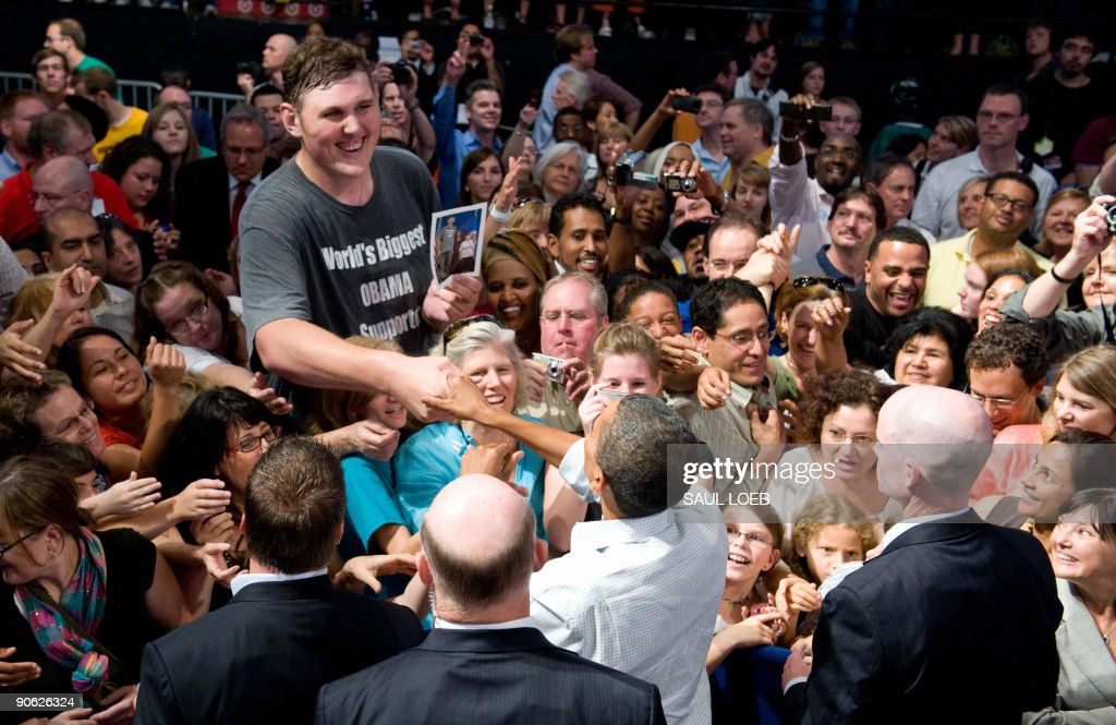 US President <a gi-track='captionPersonalityLinkClicked' href=/galleries/search?phrase=Barack+Obama&family=editorial&specificpeople=203260 ng-click='$event.stopPropagation()'>Barack Obama</a> shakes hands with 7-foot, 8-inch (2.3-meter) supporter Igor Vovkovinskiy, 27, of Rochester, Minnesota, after speaking about healthcare reform during a rally at the Target Center in Minneapolis, Minnesota, September 12, 2009. AFP PHOTO / Saul LOEB