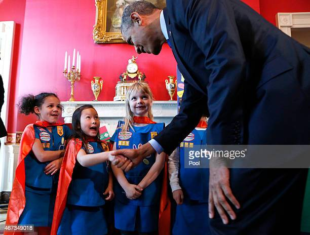 S President Barack Obama shakes hands with a group of sixyearold Girls Scouts from Tulsa Oklahoma who designed a battery powered page turner to help...