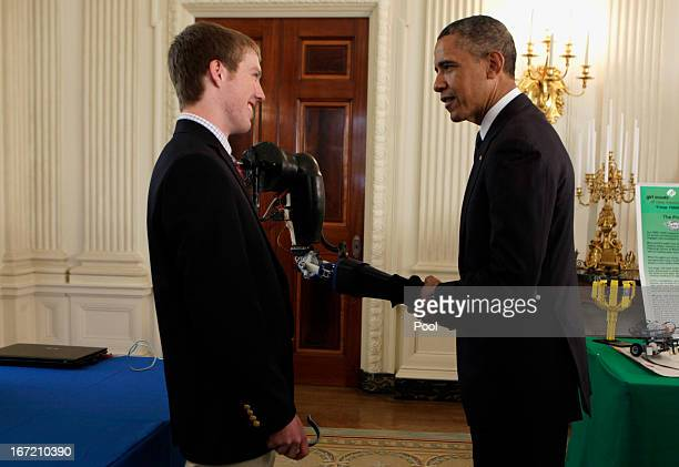 US President Barack Obama shakes hands with a robotic arm created and presented by second place winner at International Science and Engineering Fari...