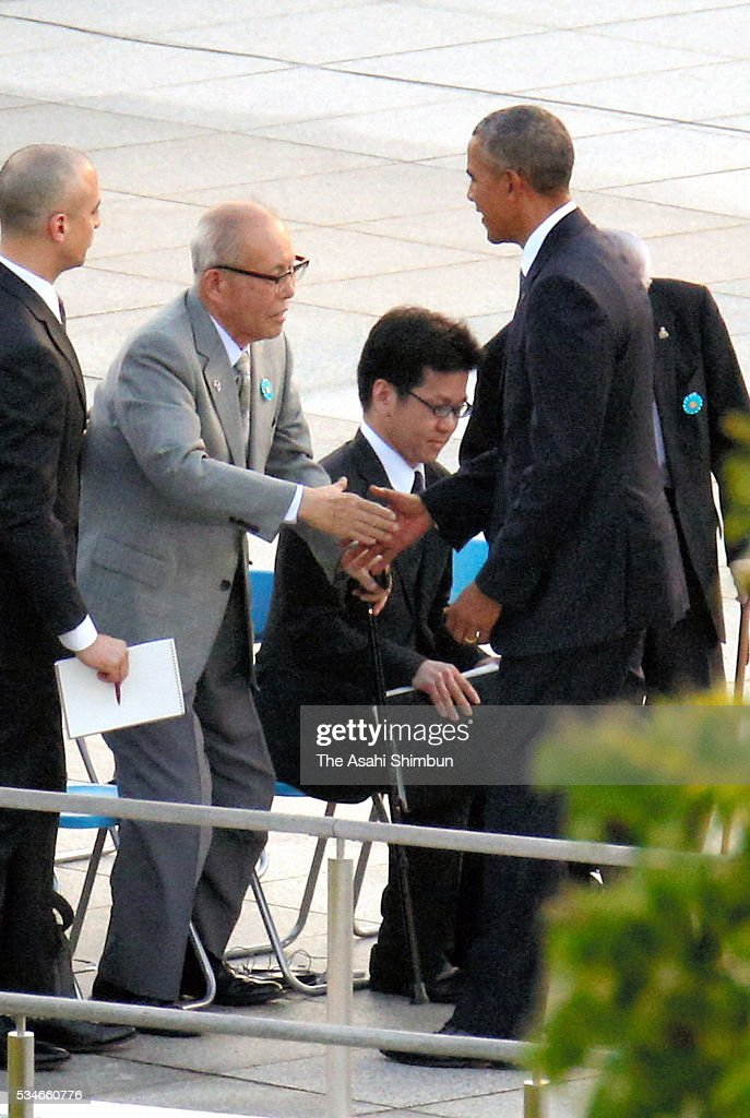 U.S. President Barack Obama (R) shakes hands with a-bomb survivors Shigeaki Mori (2nd L) after offering wreaths at the cenotaph at the Hiroshima Peace Memorial Park on May 27, 2016 in Hiroshima, Japan. Obama becomes the first sitting U.S. president to visit Hiroshima, where the first atomic bomb was dropped in 1945 at the end of World War II.