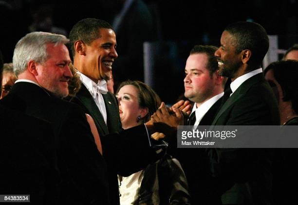President Barack Obama shakes hands with actor Denzel Washington during the Neighborhood Inaugural Ball on January 20 2009 in Washington DC President...