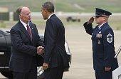 US President Barack Obama shakes hands with Alabama Governor Robert Bentley upon arrival on Air Force One at BirminghamShuttlesworth International...