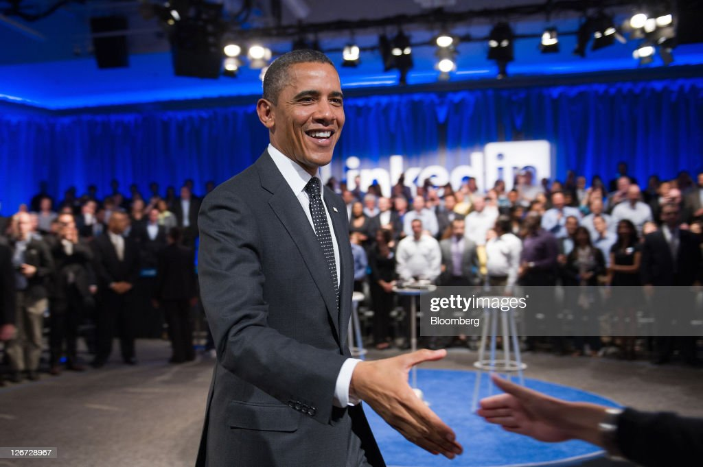 U.S. President <a gi-track='captionPersonalityLinkClicked' href=/galleries/search?phrase=Barack+Obama&family=editorial&specificpeople=203260 ng-click='$event.stopPropagation()'>Barack Obama</a> shakes hands with an audience member during a town hall event sponsored by Linkedin Corp. in Mountain View, California, U.S., on Monday, Sept. 26, 2011. Obama said his $447 billion jobs proposal will give the U.S. economy the 'jump start' it needs to revive job growth. Photographer: David Paul Morris/Bloomberg via Getty Images