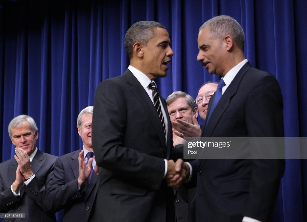 U.S. President <a gi-track='captionPersonalityLinkClicked' href=/galleries/search?phrase=Barack+Obama&family=editorial&specificpeople=203260 ng-click='$event.stopPropagation()'>Barack Obama</a> shakes hands with Attorney General <a gi-track='captionPersonalityLinkClicked' href=/galleries/search?phrase=Eric+Holder&family=editorial&specificpeople=1060367 ng-click='$event.stopPropagation()'>Eric Holder</a> (R) afer signing the Claims Resolution Act of 2010 along with administration officials, member of congress and congressional staff on December 8, 2010 in Washington, D.C. The bill will end a disputed Cobell v. Salazar Indian trust fund lawsuit against the federal government.