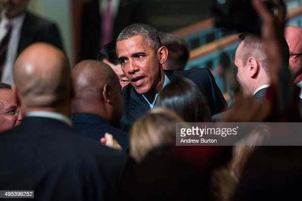 S President Barack Obama shakes hands with audience members after speaking at the Rutgers UniversityNewark SI Newhouse Center for Law and Justice on...