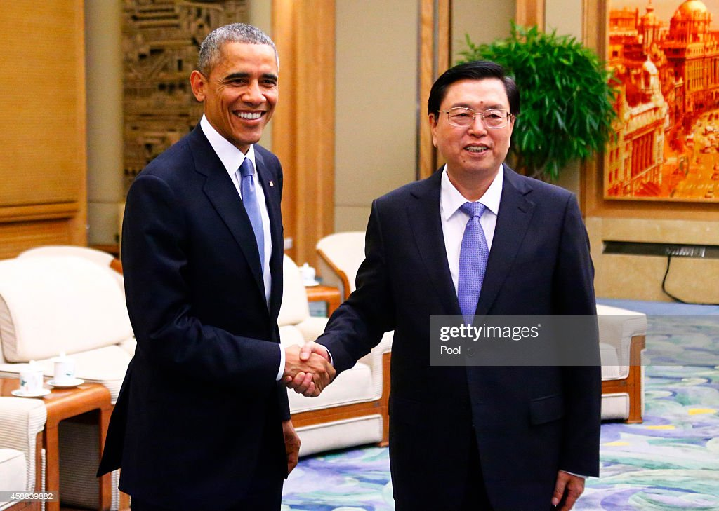 U.S. President Barack Obama (L) shakes hands with Chairman of the Standing Committee of the National People's Congress (NPC) Zhang Dejiang during a meeting at the Great Hall of the People on November 12, 2014 in Beijing, China. Obama is on a state visit, after attending the APEC summit, during a week-long trip to the Asia-Pacific.