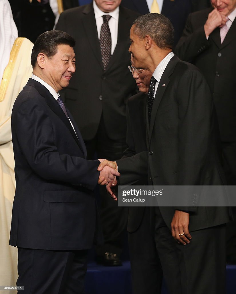 U.S. President <a gi-track='captionPersonalityLinkClicked' href=/galleries/search?phrase=Barack+Obama&family=editorial&specificpeople=203260 ng-click='$event.stopPropagation()'>Barack Obama</a> (R) shakes hands with Chiense President <a gi-track='captionPersonalityLinkClicked' href=/galleries/search?phrase=Xi+Jinping&family=editorial&specificpeople=2598986 ng-click='$event.stopPropagation()'>Xi Jinping</a> following the group photo at the 2014 Nuclear Security Summit on March 25, 2014 in The Hague, Netherlands. Leaders from around the world have come to discuss matters related to international nuclear security, though the summit is overshadowed by recent events in Ukraine.