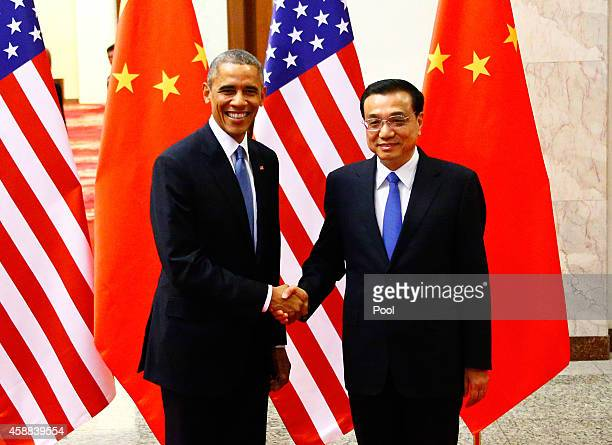 S President Barack Obama shakes hands with China's Premier Li Keqiang during a meeting at the Great Hall of the People on November 12 2014 in Beijing...