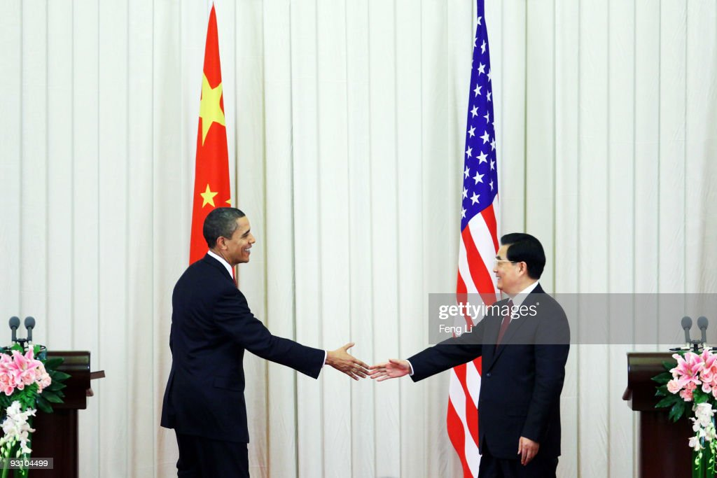 US President <a gi-track='captionPersonalityLinkClicked' href=/galleries/search?phrase=Barack+Obama&family=editorial&specificpeople=203260 ng-click='$event.stopPropagation()'>Barack Obama</a> shakes hands with Chinese President <a gi-track='captionPersonalityLinkClicked' href=/galleries/search?phrase=Hu+Jintao&family=editorial&specificpeople=203109 ng-click='$event.stopPropagation()'>Hu Jintao</a>after a joint press conference at the Great Hall of People on November 17, 2009 in Beijing, China. Obama is on an official nine-day, four nation, Asia tour during which he has visited Japan and attended the APEC Summit in Singapore before heading to China. Following his vist to China, where he is expected to discuss the economy, trade and climate change, he will head to South Korea.