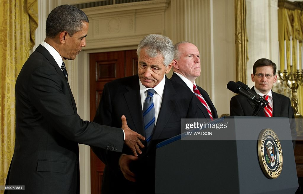 US President Barack Obama (L) shakes hands with Chuck Hagel (2nd L), who was nominated as US Defense Secretary, as Director of the Central Intelligence Agency nominee ohn Brennan (2nd R) and Acting CIA Director Micheal Morell (R) watch during an event with at the White House in Washington, DC, January 7, 2013. AFP Photo/Jim WATSON