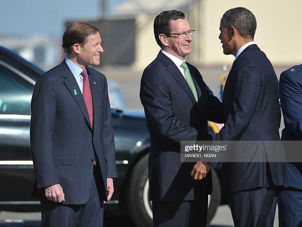 US President Barack Obama shakes hands with Connecticut Governor Dannel Malloy as Senator Richard Blumenthal (L) watches upon Obama's arrival at Bradley Air National Guard Base in Hartford, Connecticut, on April 8, 2013. Obama is in Hartford to speak on gun control at the University of Hartford. AFP PHOTO/Mandel NGAN