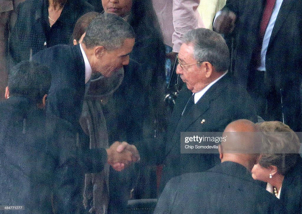 U.S. President Barack Obama (L) shakes hands with Cuban President Raul Castro during the official memorial service for former South African President Nelson Mandela at FNB Stadium December 10, 2013 in Johannesburg, South Africa. Over 60 heads of state have travelled to South Africa to attend a week of events commemorating the life of former South African President Nelson Mandela. Mr Mandela passed away on the evening of December 5, 2013 at his home in Houghton at the age of 95. Mandela became South Africa's first black president in 1994 after spending 27 years in jail for his activism against apartheid in a racially-divided South Africa.