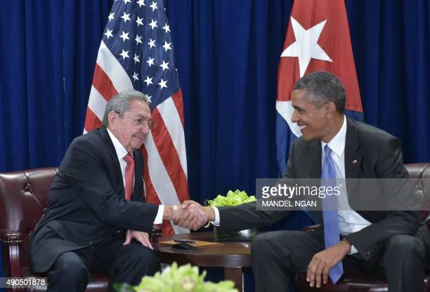 US President Barack Obama shakes hands with Cuba's President Raul Castro during a bilateral meeting on the sidelines of the United Nations General...