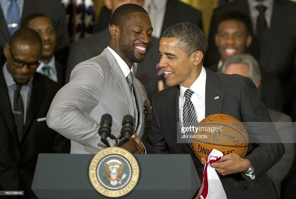 US President Barack Obama (R) shakes hands with Dwyane Wade as he welcomes the NBA Champion Miami Heat to the White House to honor the team and their 2012 NBA Championship victory at the White House in Washington, DC, January 28, 2013. AFP PHOTO/Jim WATSON