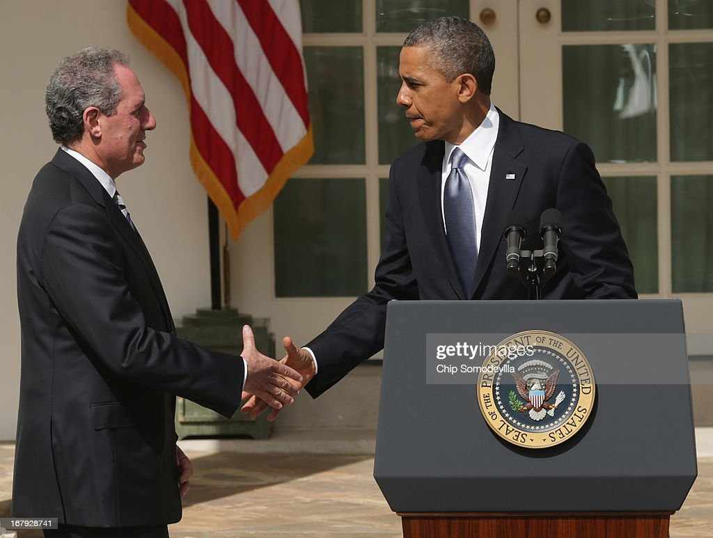 U.S. President <a gi-track='captionPersonalityLinkClicked' href=/galleries/search?phrase=Barack+Obama&family=editorial&specificpeople=203260 ng-click='$event.stopPropagation()'>Barack Obama</a> shakes hands with economic adviser Mike Froman after announcing his nomination for trade representative in the Rose Garden at the White House May 2, 2013 in Washington, DC. If approved by the Senate, the appointments of Froman and Penny Pritzker for Commerce Secretary will round out the administration's economic team for Obama's second term.