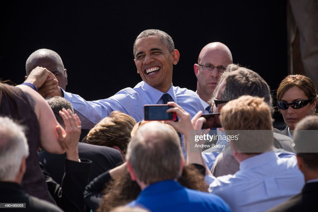 U.S. President Barack Obama shakes hands with fans after delivering remarks on infrastructure in the United States at the Washington Irving Boat Club on May 14, 2014 in Tarrytown, New York. Tomorrow President Obama will attend the opening of the National September 11 Memorial and Museum.
