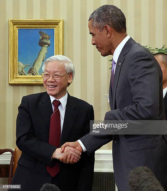 S President Barack Obama shakes hands with General Secretary Nguyen Phu Trong of Vietnam during a meeting in the Oval Office of the White House July...