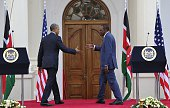 US President Barack Obama shakes hands with his Kenyan counterpart Uhuru Kenyatta as they leave after a press conference following their talks at the...
