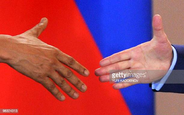 US President Barack Obama shakes hands with his Russian counterpart Dmitry Medvedev during a news conference after signing the new Strategic Arms...