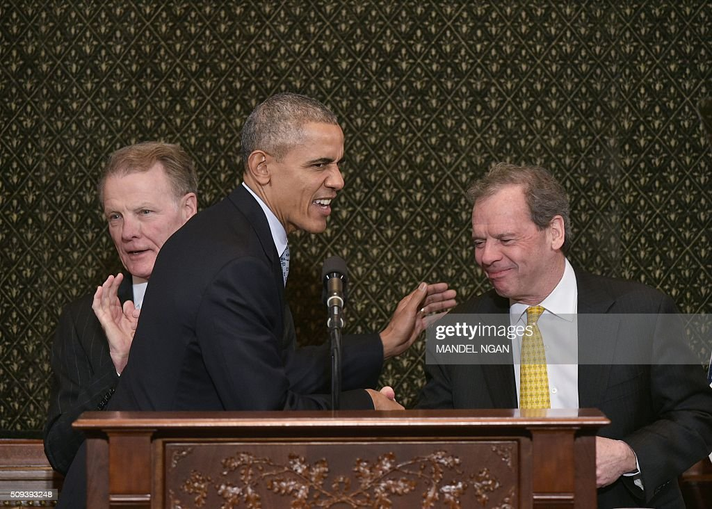 US President Barack Obama shakes hands with Illinois Senate President John Cullerton (R) as Illinois House Speaker Michael Madigan (L) watch as he arrives to address the Illinois General Assembly at the Illinois State Capitol in Springfield, Illinois on February 10, 2016. / AFP / Mandel Ngan