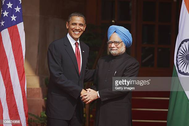 S President Barack Obama shakes hands with Indian Prime Minister Manmohan Singh ahead of their meeting at Hyderabad House on November 8 2010 in New...