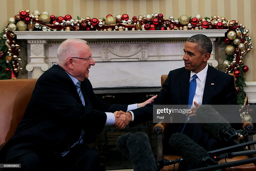 US President Barack Obama shakes hands with Israeli President Reuven Rivlin during a bilateral meeting in the Oval Office of the White House on December 9, 2015 in Washington, DC.