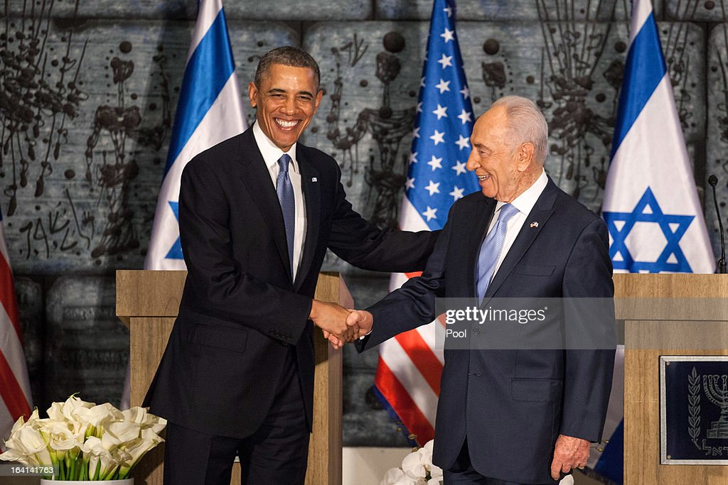 U.S. President Barack Obama (L) shakes hands with Israeli President Shimon Peres (R) during a welcome ceremony at the President's residence on March 20, 2013 in Jerusalem, Israel. This will be Obama's first visit as president to the region, and his itinerary will include meetings with the Palestinian and Israeli leaders as well as a visit to the Church of the Nativity in Bethlehem.