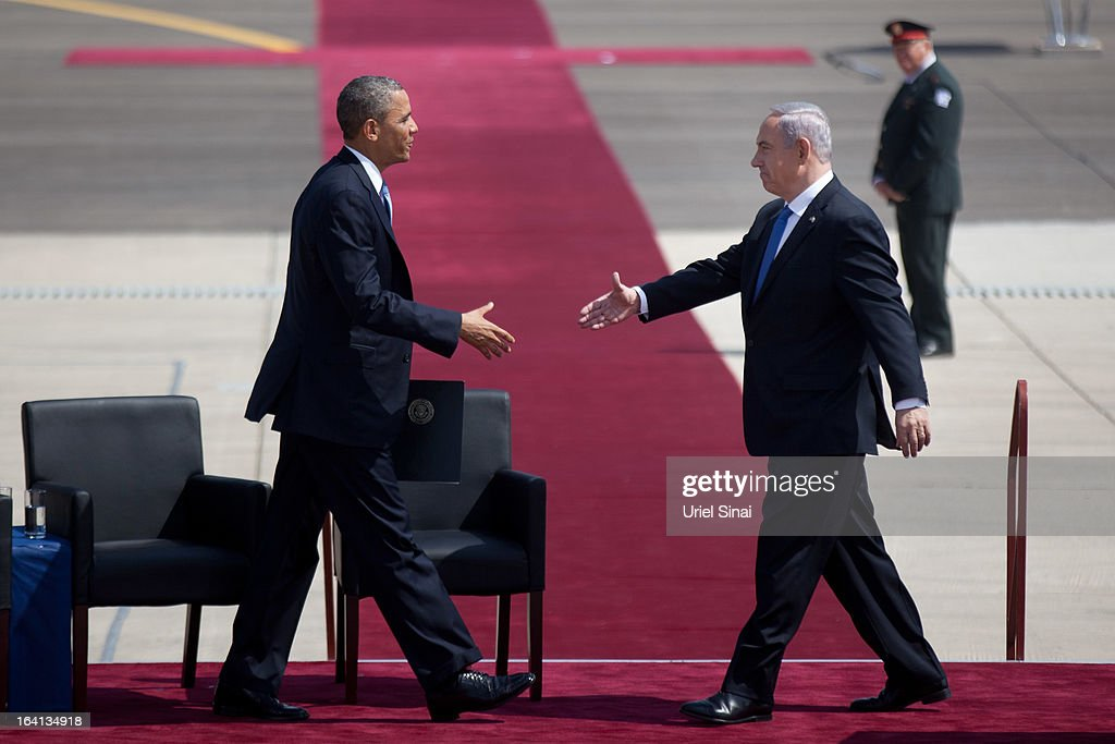 US President Barack Obama shakes hands with Israeli Prime Minister Benjamin Netanyahu during an official welcoming ceremony on his arrival at Ben Gurion International Airport on March, 20, 2013 near Tel Aviv, Israel. This will be Obama's first visit as President to the region, and his itinerary will include meetings with the Palestinian and Israeli leaders as well as a visit to the Church of the Nativity in Bethlehem.