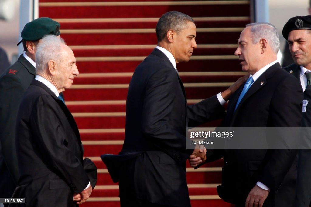 U.S. President Barack Obama (C) shakes hands with Israeli Prime Minister Benjamin Netanyahu (2nd R) as Israeli President Shimon Peres (L) looks on prior to Obama departing from Ben Gurion International Airport on March 22, 2013 in Lod' Israel. Obama concluded his first visit to Israel and West Bank after three-days of meetings with Israeli and Palestinian leaders.