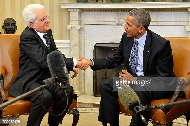 US President Barack Obama shakes hands with Italian President Sergio Mattarella after a bilateral meeting and remarks to the press in the Oval Office...