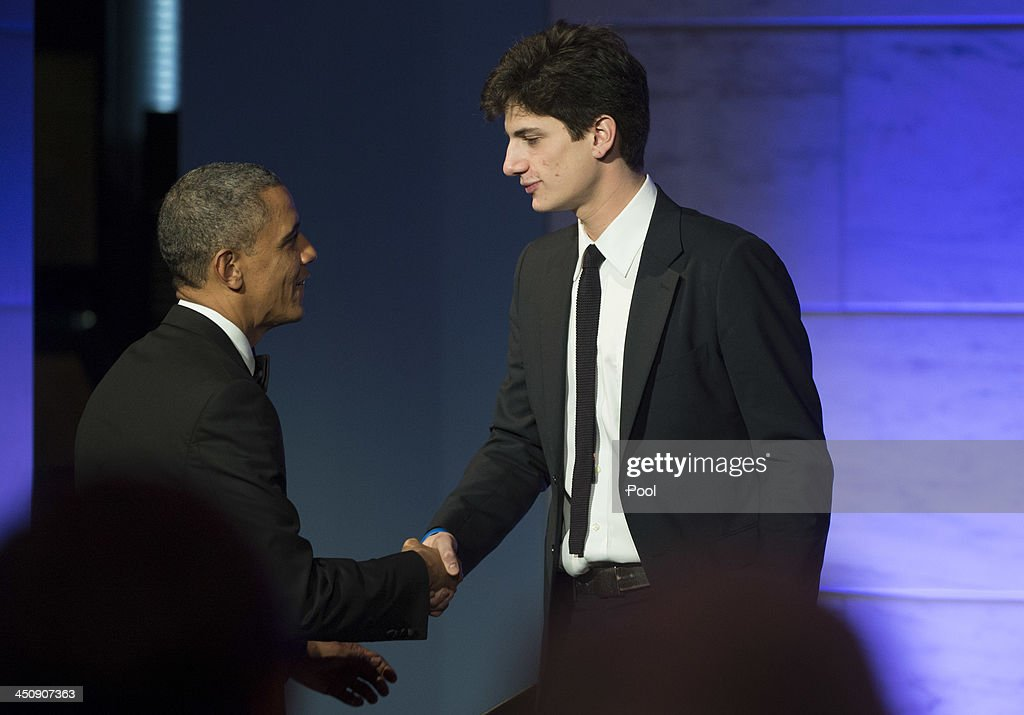 President <a gi-track='captionPersonalityLinkClicked' href=/galleries/search?phrase=Barack+Obama&family=editorial&specificpeople=203260 ng-click='$event.stopPropagation()'>Barack Obama</a> shakes hands with Jack Schlossberg, the Grandson of President John F. Kennedy, after he introduced Obama, during a dinner in honor of the Medal of Freedom awardees at the Smithsonian National Museum of American History on November 20, 2013 in Washington, DC. The Presidential Medal of Freedom is the nation's highest civilian honor, presented to individuals who have made meritorious contributions to the security or national interests of the United States, to world peace, or to cultural or other significant public or private endeavors.
