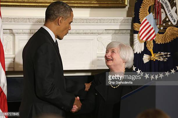 S President Barack Obama shakes hands with Janet Yellen during a press conference to nominate her to head the Federal Reserve in the State Dining...